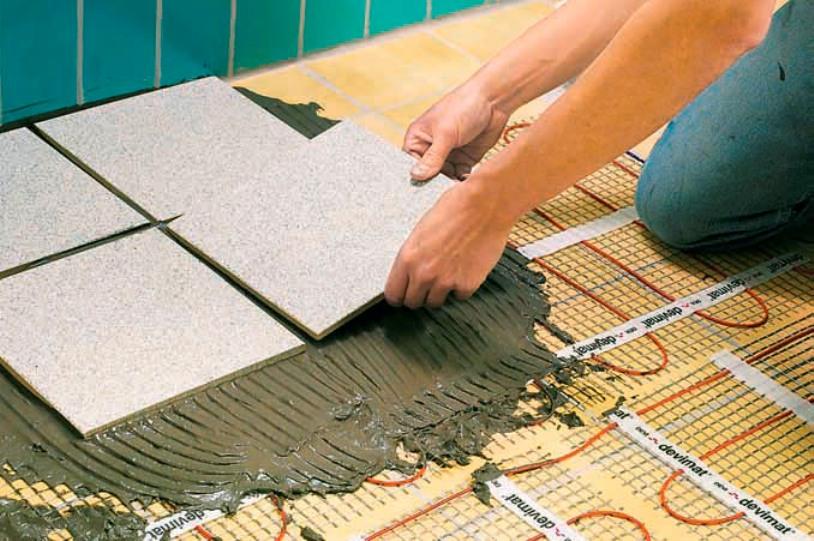 Как положить плитку на теплый пол своими руками
